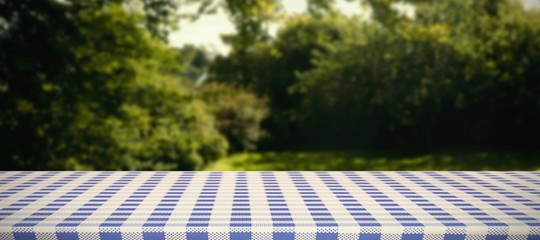 Composite image of blue and white tablecloth