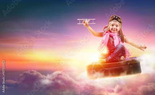Fotobehang Child Flying With Fantasy On Suitcase In The Sky