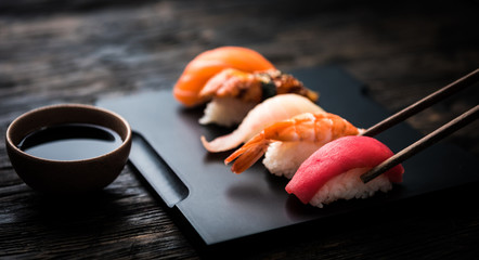 Photo sur Aluminium Sushi bar close up of sashimi sushi set with chopsticks and soy