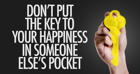 Hand writing the text: Don't Put The Key to Happiness in Someone Else's Pocket