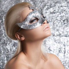 young woman in silver mask