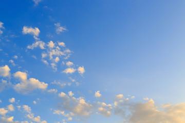 cloudy on clear blue sky