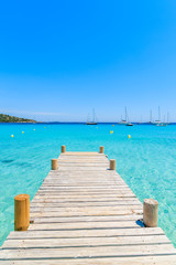 Poster Caraïben Wooden pier and crystal clear turquoise sea water on Santa Giulia beach, Corsica island, France