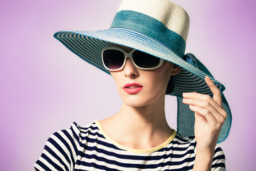 Portrait of elegant sexy woman with hat and sunglasses. Fashion and beauty concept.
