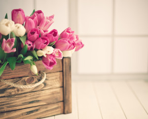 Pink and white tulips in a vintage wood crate