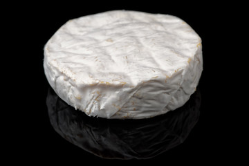 Brie cheese isolated on black background