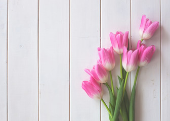 Pink tulips over white wood