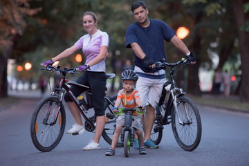young family with bicycles