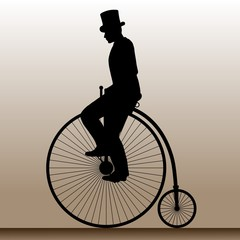 Vintage bicycle. The man in the hat on an old bicycle.