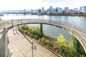 footpath near water and cityscape and skyline in portland