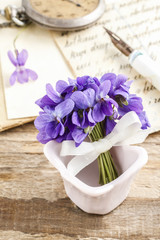 Garden Poster Pink Bouquet of violet flowers (viola odorata) and paper card