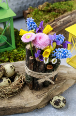 Spring table decoration with sticks and fresh flowers