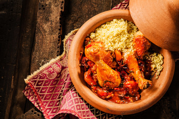 Traditional Tajine Dish with Chicken and Couscous