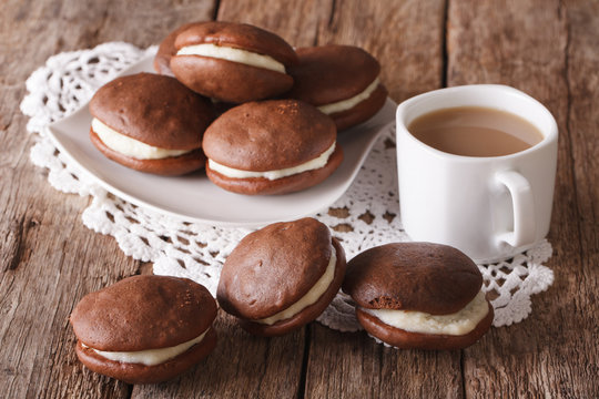American Whoopie pie pastry and coffee with milk close-up. horizontal