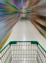 shopping cart in supermarket with motion blur