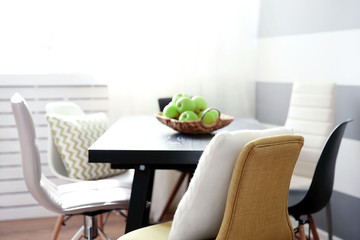 Modern room interior with table and chairs