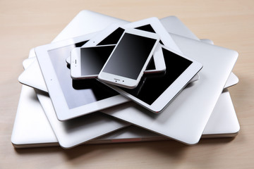Stack of electronic device on wooden table