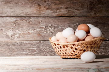 basket of eggs on the table, on the farm