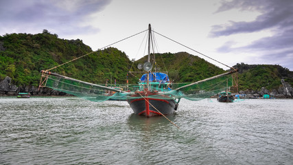 Traditional Vietnamese fishing boats with large nets