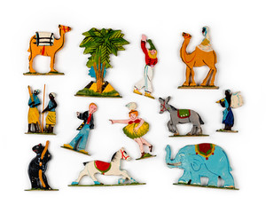 Collection of antique and vintage circus play set miniatures on a white background