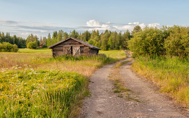 Traditional hay barn near Kalix during a summer evening in northern Sweden