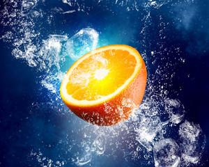 Juicy orange in water