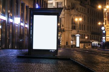 billboard at bus stop at night