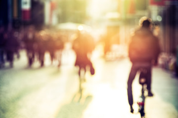 People and cyclist in the street, urban, abstract blurry Fototapete