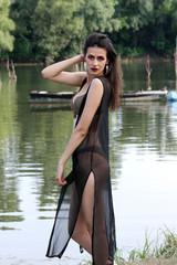 women summer posing river bikini