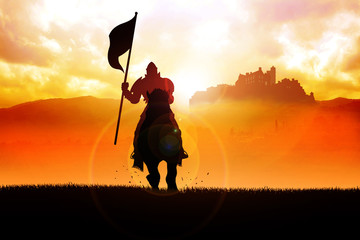 Silhouette of a medieval knight on horse carrying a flag Wall mural