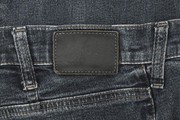 Leather jeans label sewed on black jeans