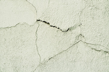 Architectural background with curved cracks on the old stucco surface