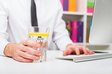Man drinking water at office