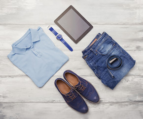 Man's clothing, watch and tablet