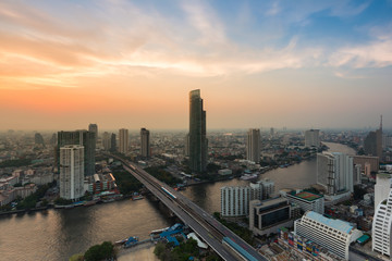 Bangkok city downtown with river curved and beautiful sky during twilight