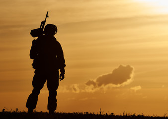 Military soldier silhouette with machine gun