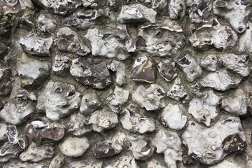 Flint stone wall in Wiltshire, Uk, texture or background full frame.