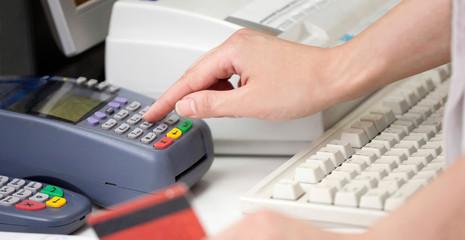 POS Terminal Transaction. Hand Swiping a Credit Card.