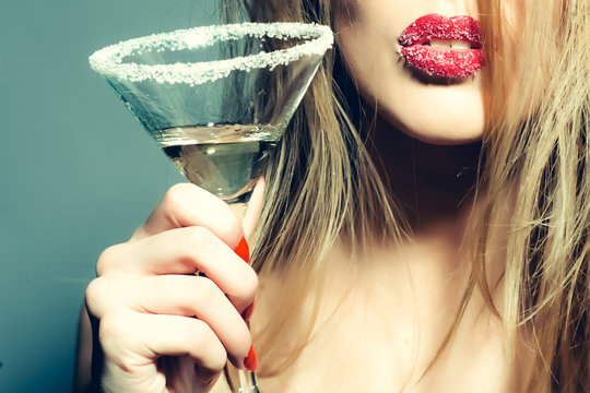 Glass of martini in female hands