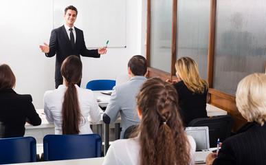 Professor and professionals at courses