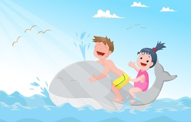 happy little children riding whale