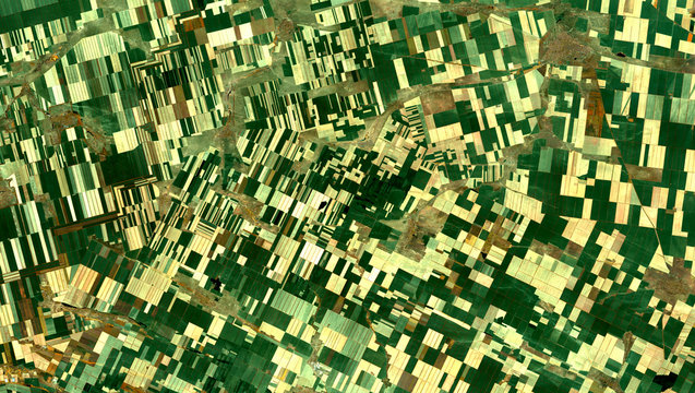 Fields from Landsat satellite. Elements of this image furnished by NASA.