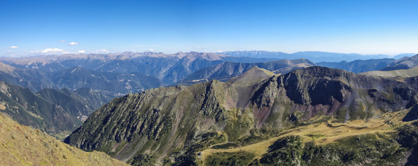 Panorama of the Pyrenees mountains in Andorra, from top of Coma Pedrosa peak.