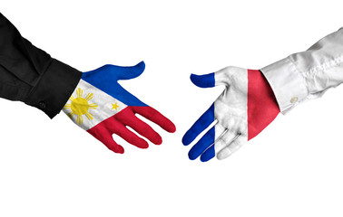 Philippines and France leaders shaking hands on a deal agreement