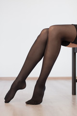 Young beautiful girl straightens stockings