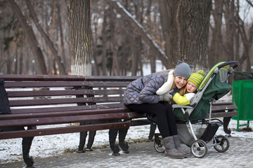 Mother with two year old son in winter park