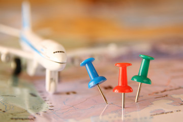 pins attached to map, showing location or travel destination . retro style image. selective focus.