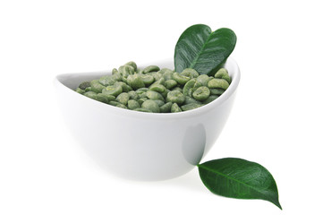 Wall Mural - White bowl with green coffee beans on the white