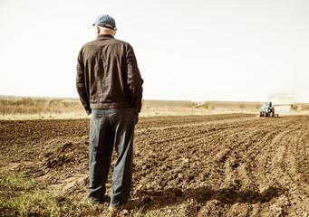 farmer on spring farmland Wall mural