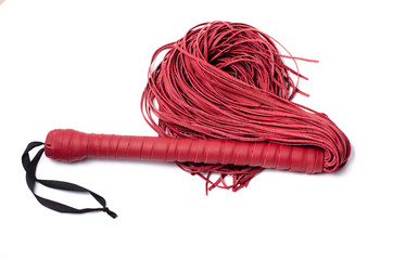 Red sex leather whip on white background